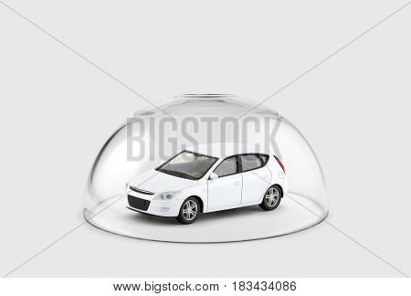 White car protected under a glass dome