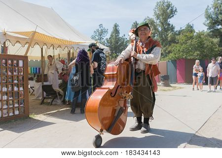 Musician With Acoustic Bass During The Renaissance Pleasure Faire.