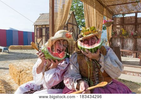 Participants Wearing Vintage Clothes, Eating Watermelon