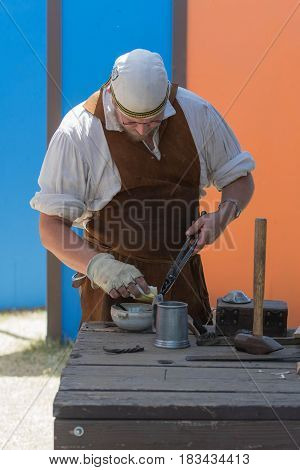 Blacksmith Working On Metal During The Renaissance Pleasure Faire.