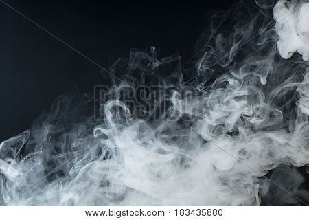 Abstract white water vapor on a black background. Texture. Design elements. Abstract art.