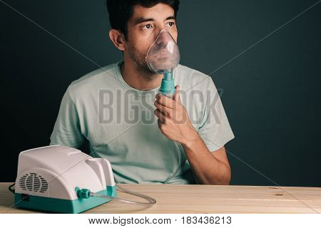 Portrait Of Young Man Using Inhaler / Nebulizer