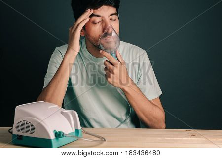 Portrait Of Man Using Domestic Inhaler / Nebulizer With Sinusitis Symptoms
