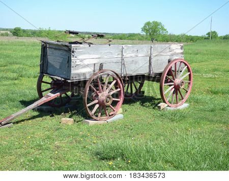 A horse drawn buck wagon with wooden wheels  used in the 19th century for hauling goods.