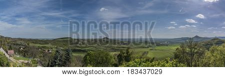 Green panorama view of Ceske Stredohori mountains and valley of river Labe