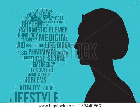 Black silhouette of woman's profile covered with medical science keywords on light blue background; suitable for health care medical and psycology topics background.