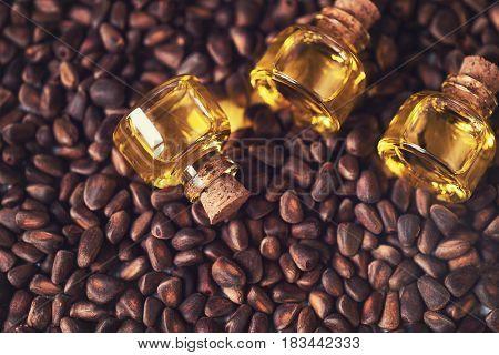 The cedar oil in a glass bottles on the cedar nuts