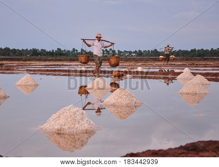 People Working On Salt Field In Cambodia