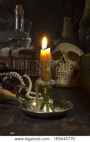 Gothic still life with a skull and a candle