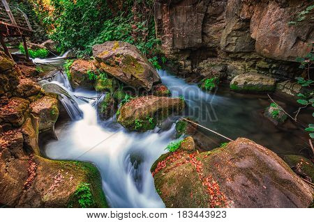 Banias river at north of Israel, flowing over rocks, shot with long exposure technique.