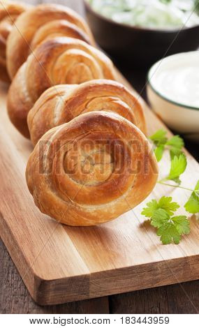 Phyllo pastry cheese pies served with yoghurt and salad