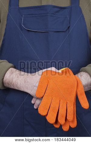 Man in working clothes with gloves. Isolated on a white background.