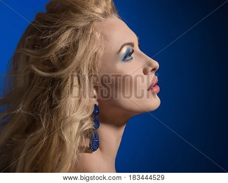 Side view portrait of elegant beautiful woman with bright make-up