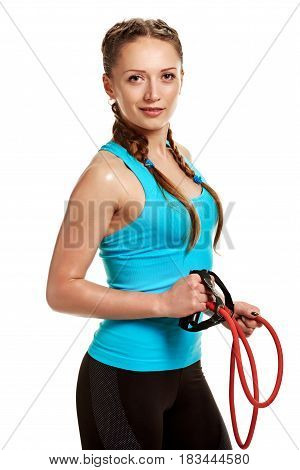 Smiling sporty woman doing exercises with stretching expander