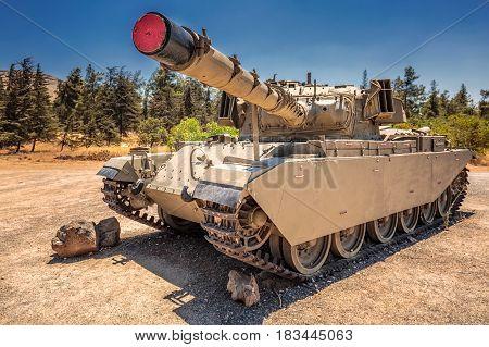 Old Israeli tank standung in the field, Ramat Hagolan, Israel.