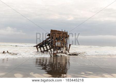 Skeleton of ship remnants in the Peter Iredale shipwreck. Fort Stevens State Park Oregon USA.