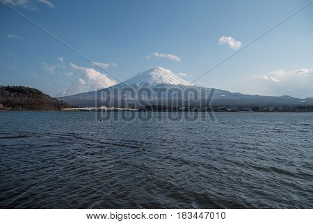 scenic landscape of Fuji mountain (Fujisan) in spring season beautiful snowcapped volcano and famous natural landmark of Japan view from Kawaguchi lake in Yamanashi Prefecture Japan