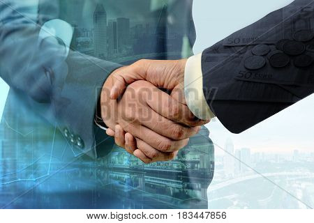 Double exposure of handshake between businessman with cityscape and EURO money - Business concept Immovable property concept