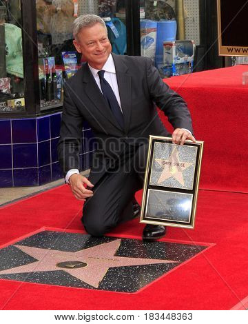 LOS ANGELES - APR 17:  Gary Sinise at the Gary Sinise Honored With Star On The Hollywood Walk Of Fame on April 17, 2017 in Los Angeles, CA