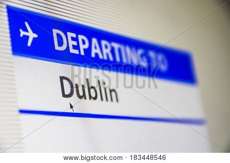 Computer screen close-up of status of flight departing to Dublin, Eire, Ireland