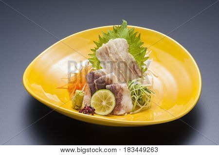 Fried Sliced Pork With Wasabi And Sliced Lime On Platter