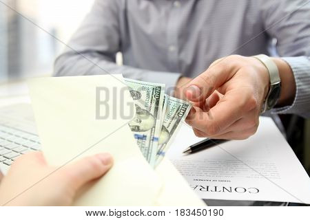 business man take a bribery during a signing a contract
