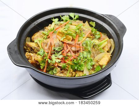 Sauteed Pork In Black Stew With Chili, Onion And Herbs