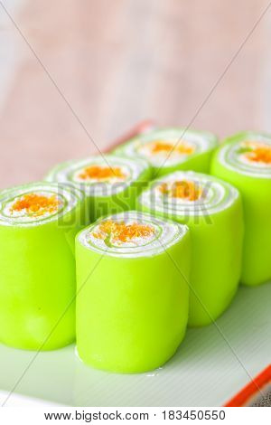 Close up green roll cake for breakfast