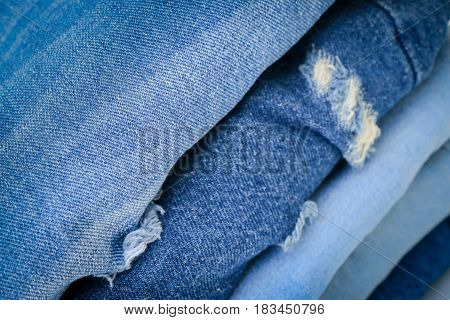 Close up stacked fashion blue jeans closeup