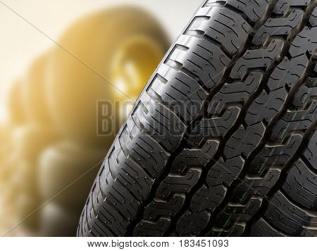 Close up tires with sun flare for sell in tires shop