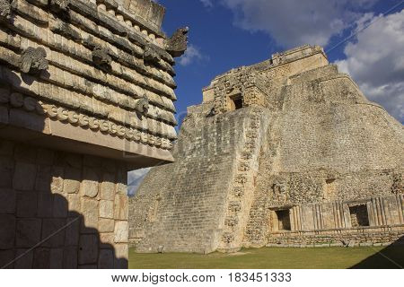 The ancient Mayan ruins of Uxmal on the Yucatan Peninsula of Mexico. Uxmal is known for its detailed stonework and the Pyramid of the Magician, whose rounded edges are unique.