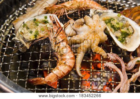 Grilling Seafood Of Shrimp, Octopus And Oysters On Hot Charcoal