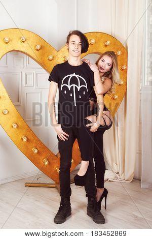 couple in black cloth near golden heart