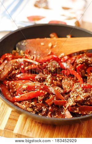 Sauteed Beef With Red Chili In Black Pan