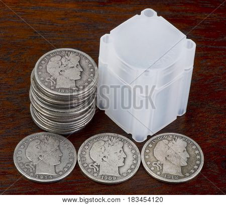 American antique Barber silver half dollars on table.