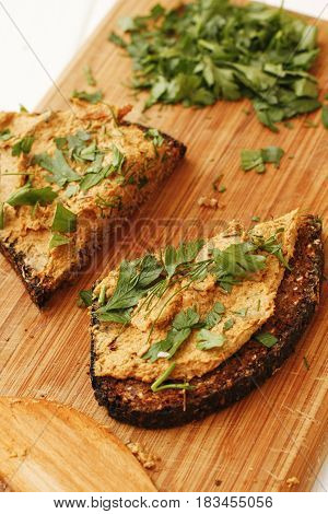 Chanterelle Mushroom Pate With Herbs On Wooden Board