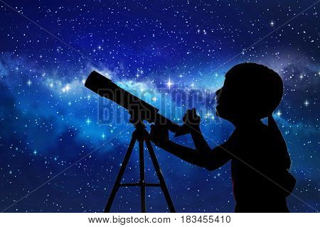 Silhouette Of Little Girl Looking Through A Telescope