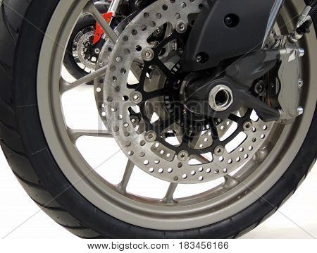 Brake disc on the front wheel of sport motorcycle at moto shop stock photo