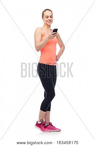 sport, fitness, technology, lifestyle and people concept - happy smiling sportive young woman with smartphone
