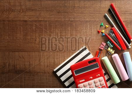 Different stationery on wooden background