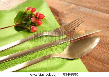 Table setting with golden cutlery and napkin, close up
