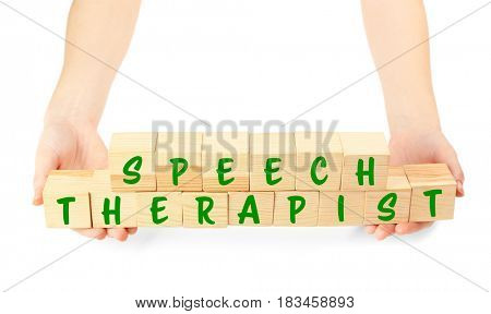 Speech therapy concept. Hands holding cubes on white background