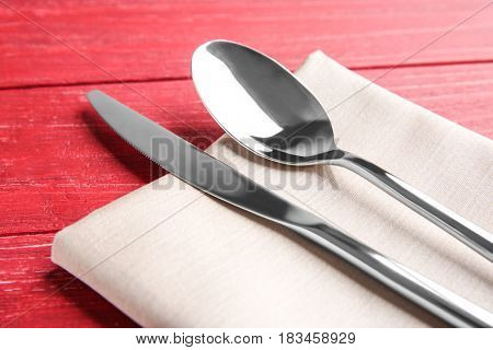 Table setting with cutlery and napkin, close up