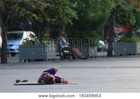 HO CHI MINH CITY VIETNAM - NOVEMBER 30, 2016: Unidentified child sleeps on street in downtown Ho Chi Minh City.