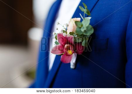 stylish buttonhole of the groom from rose