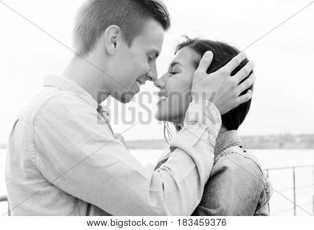 Beautiful young couple on river shore