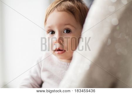 family, childhood and people concept - close up of sweet little baby girl with mother