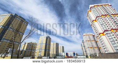 е	The facade of the new residential high-rise buildings against the sky . The concept of building a typical residential neighborhood