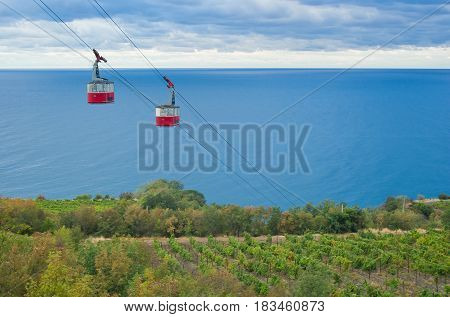 Autumnal landscape with a cable-way to the Black Sea on the Crimean resort shore