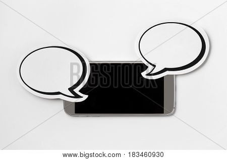 Mobile phone sideways in horizontal position with 2 speech bubbles. Smartphone with blank screen. Free copy space for text. Paper speech balloon and cellphone on white background. Chat concept.